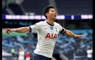 Tottenham's Son Heung-min celebrates after scoring his side's first goal during the English Premier League match against Arsenal at the Tottenham Hotspur Stadium in London, England, on Sunday.