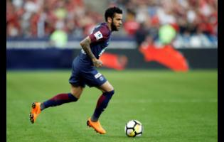 FILE - In this file photo dated  Tuesday, May 8, 2018, PSG's Dani Alves runs with the ball during the French Cup final against Les Herbiers at the Stade de France stadium in Saint-Denis, outside Paris.