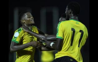 Reggae Boyz striker Leon Bailey (left) celebrates with  Devon Williams (partially hidden) and Shamar Nicholson during Jamaica's Concacaf Nations League match against Antigua and Barbuda at the Montego Bay Sports Complex on Friday, September 6,2019.
