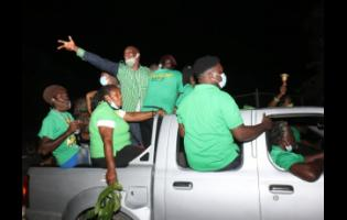 Supporters of the Jamaica Labour Party in Clarks Town, Trelawny, on Monday when Prime Minister Andrew Holness toured the area.