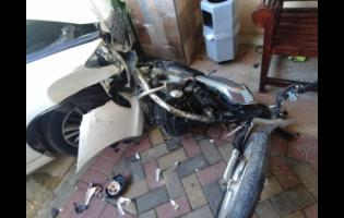 The motorbike that the men were travelling on when they attempted to rob occupants of a car.
