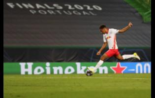 RB Leipzig's Tyler Adams scores his side's second goal during their UEFA Champions League quarterfinal match against Atletico Madrid at the Jose Alvalade stadium in Lisbon, Portugal, on Thursday.