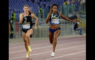 Jamaica's Elaine Thompson-Herah (right) wins in 10.85 seconds the women's 100m competition at the Golden Gala Pietro Mennea IAAF Diamond League athletics meet in Rome, yesterday.