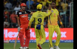 FILE Dwayne Bravo and Ambati Rayudu of Chennai Super Kings celebrate the wicket of Parthiv Patel of Royal Challengers Bangalore, as Marcus Stoinis of Royal Challengers Bangalore looks on, during the VIVO IPL T20 cricket match between Royal Challengers Bangalore and Chennai Super Kings in Bangalore, India, Sunday, April 21, 2019.