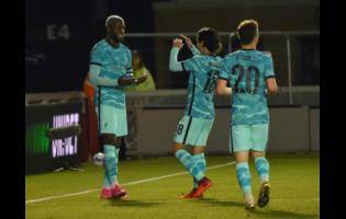 Liverpool's Divock Origi (left) celebrates with teammates after scoring his side's seventh goal during the English League Cup third-round match against Lincoln City at the LNER stadium, Lincoln, England, yesterday.