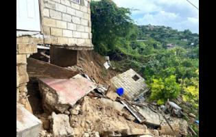 Only a part of the two-bedroom house remains at the original spot, as much of it has tumbled down the hillside.