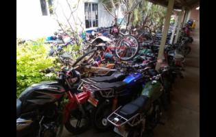 Some of the motorcycles which have been seized and impounded at a section of the Savanna-la-Mar Police Station in Westmoreland. This is just a small number are they are stored all over the station compound.