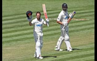 New Zealand's Kane Williamson celebrates his double century during play on day two of the first cricket test between the West Indies and New Zealand in Hamilton, New Zealand, Friday, December 4, 2020.