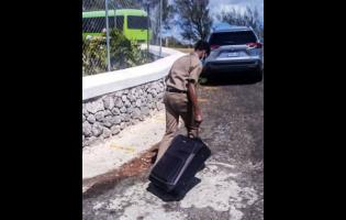 A student makes his way from Munro College in St Elizabeth in the wake of the discovery of a COVID-19 at the school recently.