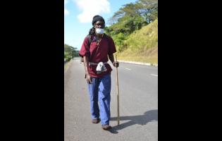Despite suffering injuries to his feet, Black X is determined to continue his walk to Jamaica House, in salute of healthcare workers and Tacky.