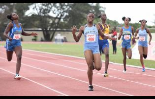 File Tina Clayton (second left) of Edwin Allen High School wins the Class Two girls' 200ms final  in 23.57 seconds, ahead of Hydel High School's Shenese Walker (left), at the 2020 Central Athletics Championships.