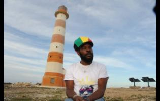 Internationally renowned entertainer, Bush Man, who is a son of St Thomas, sits in front of the Morant Point Lighthouse in the parish.