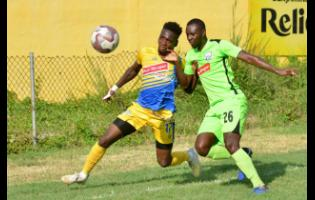 Harbour View's Damion Thomas (left) battles with Molynes United's Romario Campbell during a Jamaica Football League match at the Constant Spring Sports Complex on Thursday, November 27, 2019.
