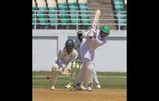 Guyana Jaguars batsman Chandrapaul Hemraj hits through the on side during his half century against the Jamaica Scorpions at the Trelawny Stadium on Saturday, November 30, 2019.