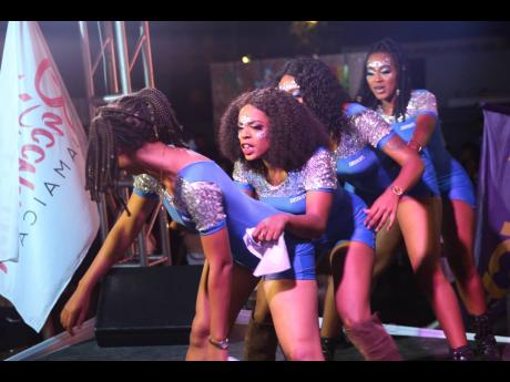 The Absolut Vodka girls make a soca train to entertain the patrons of Bacchanal and Dancehall last Friday at the Mas Camp.