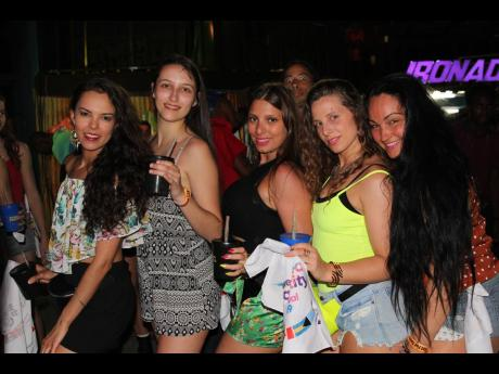 These females dancers, Amandine Texeira, Anna-Barbara Carletta, Ilaria Piedigrosso, Aurore Dinaux and Marie Kerida get into the groove at Bacchanal and Dancehall last Friday at Mas Camp.