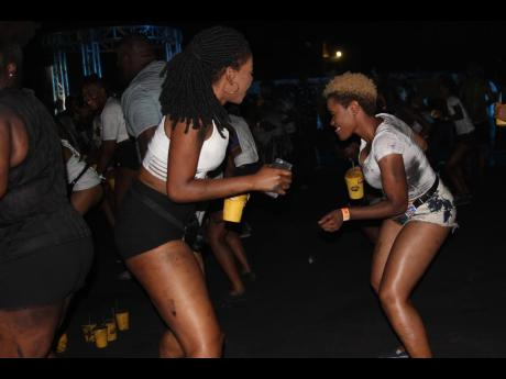 These females were having a good time in the ash-dash area of Jamaica's first charcoal jouvert last Friday.