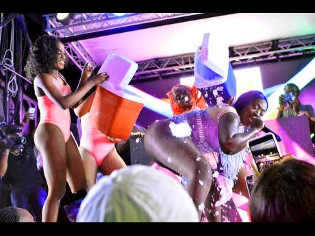 Dancers pour ice on Spice as she performs 'Cool It'.
