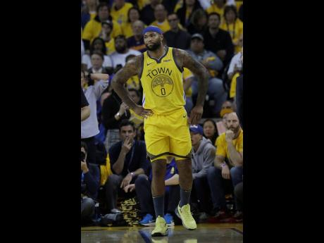 In this April 15, 2019, file photo, then-Golden State Warriors centre DeMarcus Cousins reacts after injuring his leg during the first half of Game 2 of a first-round NBA basketball play-off series against the Los Angeles Clippers.