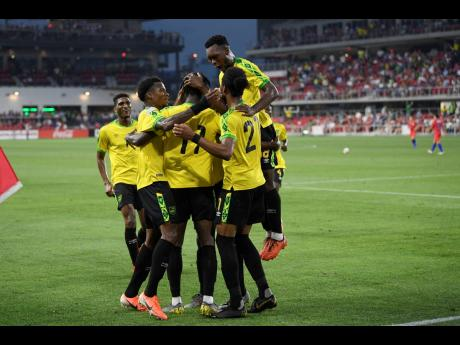 Jamaica forward Shamar Nicholson (11) celebrates his goal with his teammates during the second half of the team's international friendly  match against the United States, on Wednesday, June 5, 2019.