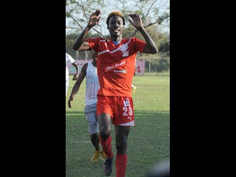 Shamar Nicholson celebrates after scoring a goal for Boys' Town in the 2016-17 Red Stripe Premier League season.