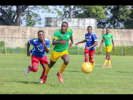 St Jago High School's Jahvel Granville turns away from Holy Trinity's High School's Shemari Glade during their scoreless draw in the ISSA/Digicel Manning Cup encounter at the Spanish Town Prison Oval last Monday.