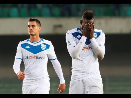 Brescia's Mario Balotelli (right) reacts at the end of the Italian Serie A match against Verona at the Bentegodi stadium in Verona on November 3.
