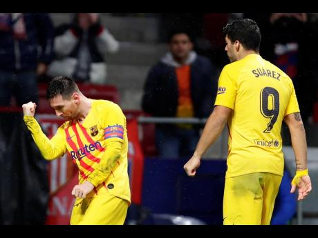 FC Barcelona's Lionel Messi celebrates after scoring his opening goal during a Spanish La Liga match between Atletico Madrid and FC Barcelona at Wanda Metropolitano stadium in Madrid, Spain, yesterday.