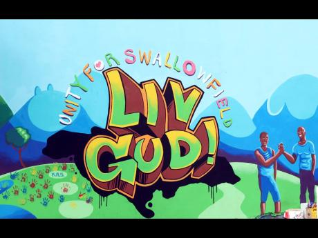The painting of positive messages on the outskirts of Swallowfield is a reminder to 'Liv Gud'.