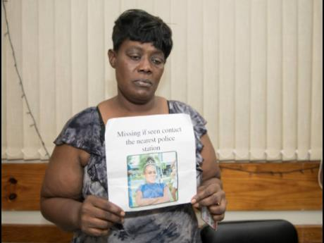Georgia Woods holds the flyer with the photo of her missing granddaughter, Ackeela Jones.