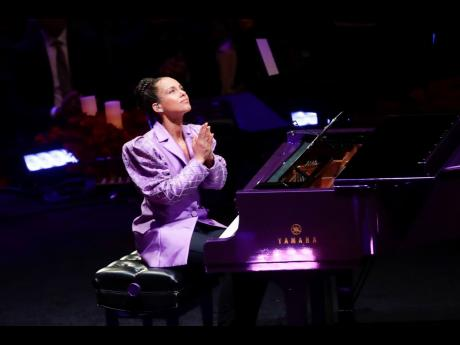 Alicia Keys looks to the heavens after performing during a celebration of life for Kobe Bryant and his daughter Gianna at Staples Center in Los Angeles, California, yesterday.