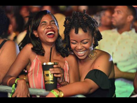 Girlfriends enjoying themselves at  Jamaica Rum Festival 2020. Presley Hype says he feeds off the energy of the patrons.