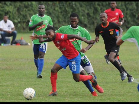 Action from a 2018 Red Stripe Premier League match between Dunbeholden and Montego Bay United at the Royal Lakes Complex in St Catherine.
