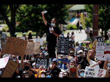 Demonstrators chant their slogans during a protest Thursday, June 4, in Los Angeles, over the death of George Floyd on May 25 in Minneapolis.