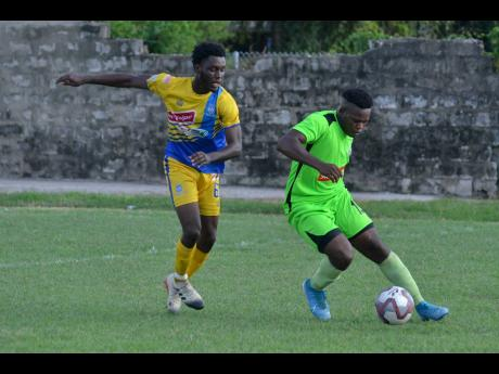 Tafari Chambers of Molynes United  FC gets away from Jermey Nelson (left) of Harbour View  FC  in a Red Stripe  Premier League match at the Constant Field, on November 27, 2019.