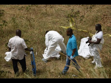 One resident said that the bodies that were found in Rivoli, St Catherine yesterday, may have been washed to the site and buried by heavy rains.