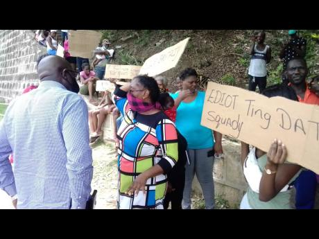 Benieve Jowrey, mother of Lineka Williams, speaks with Mayor of Lucea, Sheridan Samuels.