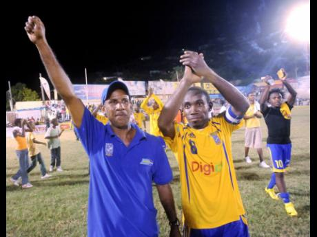 Donovan Hayles (left) and Richard Edwards wave to to the crowd after Harbour View after winning the Premier League in 2007.