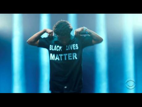 Roddy Ricch wears a shirt   'Black Lives Matter' while performing during the BET Awards.