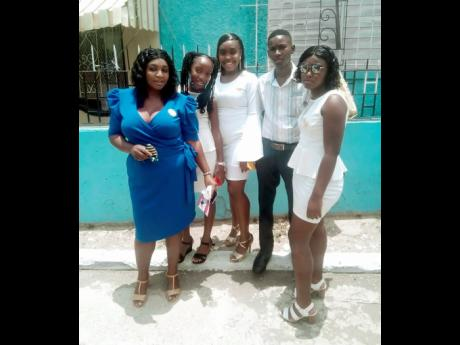 Contributed photos Kris-Ann Martin (second left) with (from left) mother Tamika Wilson, and siblings Rushana Richards, Christopher Martin, and Adrianna Richards.
