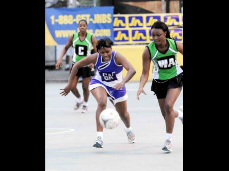 File Photos Waulgrovians' Simone Forbes (left) and Jamalco's Naudia Brown chase a loose ball during their JNA/JNBS Open League final in 2012.