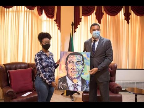 Shana-Gail Young presents Prime Minister Andrew Holness with one of her art pieces, Andrew Holness: Man of the People. The prime minister has contributed $250,000 to Young, who is seeking to complete a bachelor's degree in civil engineering, which she started in 2014.