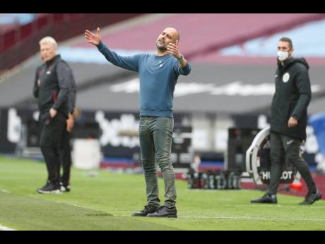 Manchester City's head coach, Pep Guardiola, reacts during the English Premier League match against  West Ham at the London Olympic Stadium on Saturday, October 24.