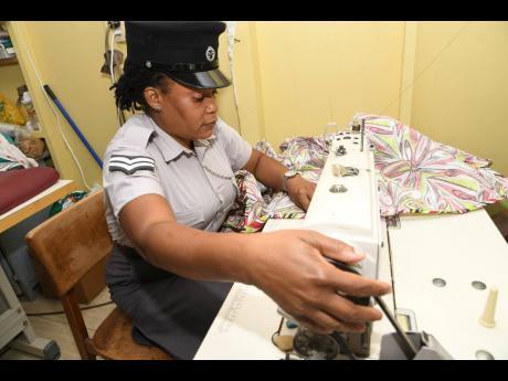 Howard-Burton sewing bedsheets for inmates.