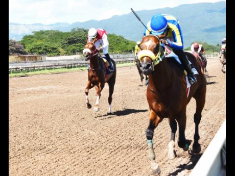 TRICKY ONE (on the rails) ridden by Oshane Nugent wins the PICK3 Simple Ting Fi Win Trophy (third race) at Caymanas Park on Sunday, November 29, 2020.