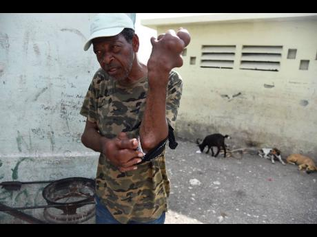 Kenneth Francis, a resident of Rae Town, Kingston, suffers from a condition which is believed to be gout.