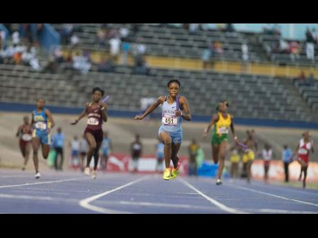 FILE Edwin Allen High School's Tia Clayton anchors their Class Two 4x100m team to victory in a record 43.73 seconds.