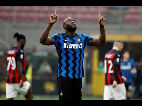 Inter Milan's Romelu Lukaku celebrates his side's 3-0 win at the end of the Serie A match between AC Milan and Inter Milan at the Milan San Siro Stadium, Italy, yesterday.