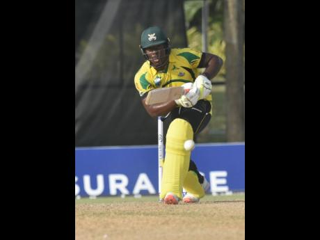 Jamaica Scorpions' Odean Smith drives through the off-side during his unbeaten innings of 68 as hist team beat the Barbados Pride yesterday to advance to the semi-final of Regional Super 50 cricket competition.