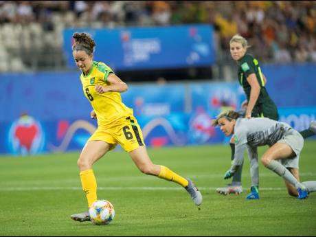 Reggae Girl Havana Solaun shoots and scores during a FIFA Women's World Cup match against Australia in 2019.